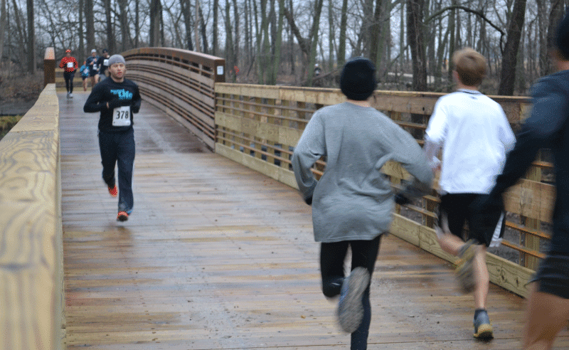 People Running on Bridge